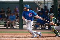 Chicago Cubs third baseman Jesse Hodges (19) follows through on his swing during a Minor League Spring Training game against the Oakland Athletics at Sloan Park on March 13, 2018 in Mesa, Arizona. (Zachary Lucy/Four Seam Images)