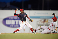 Batavia Muckdogs second baseman Samuel Castro (5) attempts to turn a double play as Branden Boggetto (3) slides in during a game against the Auburn Doubledays on June 19, 2017 at Dwyer Stadium in Batavia, New York.  Batavia defeated Auburn 8-2 in both teams opening game of the season.  (Mike Janes/Four Seam Images)