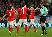 Gareth Bale of Wales (C) protests to match referee Alberto Mallenco for which he saw a yellow card during the 2018 FIFA World Cup Qualifier between Wales and Serbia at the Cardiff City Stadium, Wales, UK. Saturday 12 November 2016