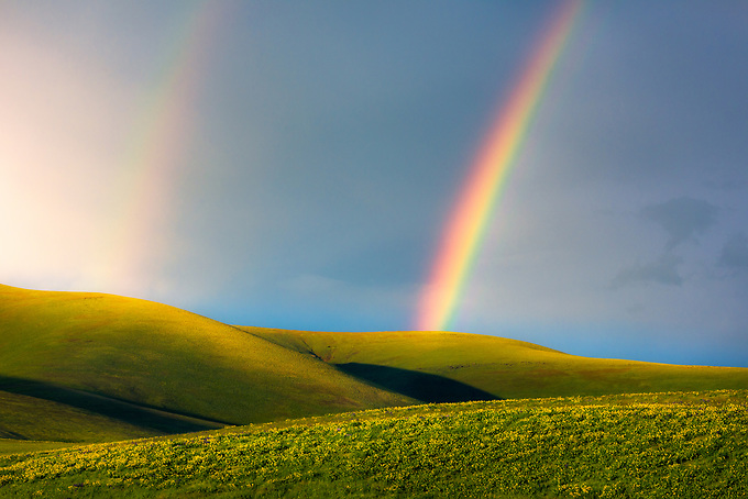 A beautiful double rainbow forms over the layered Columbia HIlls in the late afternoon on the edge of a weather front.<br /> <br /> ARTIST CHOICE: 24x36 Lumachrome/Acylic