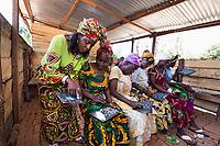 Africa, DRC, Democratic Republic of the Congo, S. Kivu, Katana. Women for Women project. Faida Rutakangwa (34), teaching numeracy and literacy to local women through WFW training.