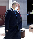 MIDDLETOWN, CT. - 06 May 2021-050621SV05-State police sergeant John McDonald, left, and his Attorney Robert Britt exit Superior Court in Middletown Thursday. McDonald pleaded no contest to two counts of reckless endangerment for the Oxford crash<br /> Steven Valenti Republican-American