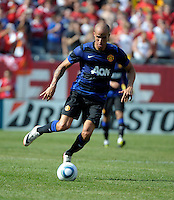 Manchester United midfielder Gabriel Obertan (26) dribbles the ball.  Manchester United defeated the Chicago Fire 3-1 at Soldier Field in Chicago, IL on July 23, 2011.