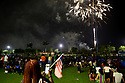 MIRAMAR, FL - JULY 04: Spectators watch the annual Independence Day fireworks display during the 4th Of July Independence Day Concert and Fireworks Display at Miramar Regional Park Amphitheater on July 4, 2021 in Miramar, Florida.  ( Photo by Johnny Louis / jlnphotography.com )