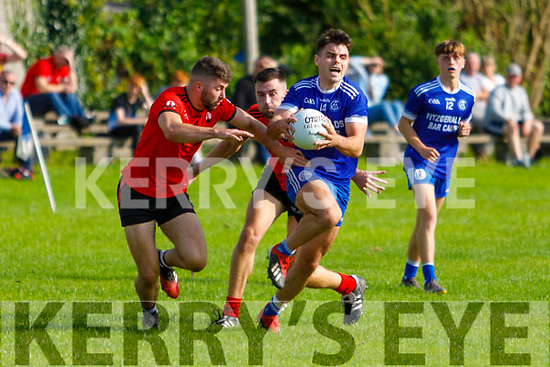 Annascaul's James Crean pushes forward despite the attention Tarberts Michael Heaphy and Brian Heaphy in the Junior Club Football Championship semi final.