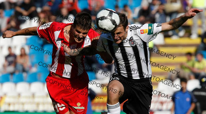 Red Star player ANdrija Kaludjerovic, and Partizan player Marko Jovanovic, right, jump for the ball, during the Serbian League soccer match in Belgrade, Serbia, Saturday, October  24, 2010. (Srdjan Stevanovic/Starsportphoto.com)