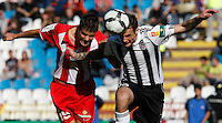 Red Star player ANdrija Kaludjerovic, and Partizan player Marko Jovanovic, right, jump for the ball, during the Serbian League soccer match in Belgrade, Serbia, Saturday, October  24, 2010. (Srdjan Stevanovic/Starsportphoto.com)