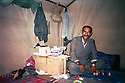 Iraq 1988 .Nou Shirwan Mustafa in his office, a tent, in the mountain in July.Irak 1988.Nou Shirwan Mustafa sous la tente lui servant de bureau dans la montagne