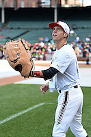 Wyatt Cross (25) of Legacy High School in Broomfield, Colorado using an large toy glove before the Under Armour All-American Game on August 16, 2014 at Wrigley Field in Chicago, Illinois.  (Mike Janes/Four Seam Images)