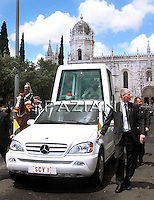 Pope Benedict XVI leaves the Jeronimos Monastery to go to Portuguese President official residence in his popemobil after the official welcome ceremony, Lisbon, Portugal, 11 May 2010. Pope Benedict XVI is on a four days official visit to Portugal to attend the annual celebrations of the Our Lady 13 May 1917 apparition to the three little sheferds and the 10th year of their beatification.