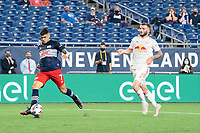 FOXBOROUGH, MA - MAY 22: Gustavo Bou #7 of New England Revolution passes the ball in front of the New York Red Bulls goal during a game between New York Red Bulls and New England Revolution at Gillette Stadium on May 22, 2021 in Foxborough, Massachusetts.
