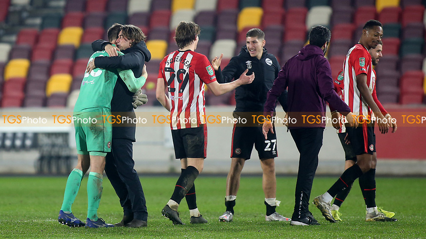 Brentford Manager, Thomas Frank celebrates their victory at the final whistle with Brentford goalkeeper, Luke Daniels during Brentford vs Newcastle United, Carabao Cup Football at the Brentford Community Stadium on 22nd December 2020