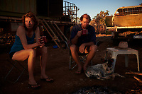 Nick and Joanna Atkins drink cups of tea before they set to work grading a mining road off the Gibb River-Kalumburu Road.