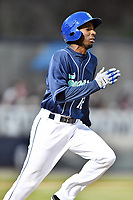 Asheville Tourists right fielder Ramon Marcelino (12) runs to first base during a game against the Columbia Fireflies at McCormick Field on April 12, 2018 in Asheville, North Carolina. The Fireflies defeated the Tourists 7-5. (Tony Farlow/Four Seam Images)