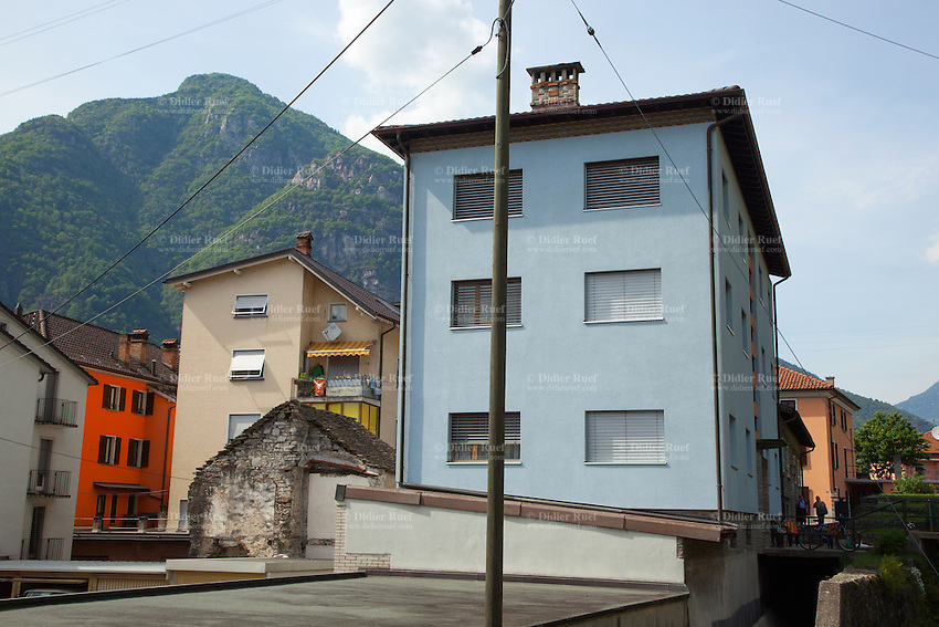 Switzerland. Canton Ticino. Biasca. Town centre. Orange and blue buildings. Siwss alps mountains. 12.05.2015 © 2015 Didier Ruef