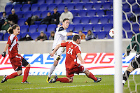 Brendan King (17) of the Notre Dame Fighting Irish takes a shot as Austin Berry (24) of the Louisville Cardinals  defends during the semi-finals of the Big East Men's Soccer Championship at Red Bull Arena in Harrison, NJ, on November 12, 2010.