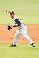 Kannapolis Intimidators third baseman Rangel Ravelo #24 makes a throw to first base against the Hagerstown Suns at CMC-Northeast Stadium on June 9, 2012 in Kannapolis, North Carolina.  The Suns defeated the Intimidators 11-6.  (Brian Westerholt/Four Seam Images)