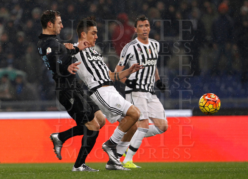 Calcio, quarti di finale di Coppa Italia: Lazio vs Juventus. Roma, stadio Olimpico, 20 gennaio 2016.<br /> Juventus' Paulo Dybala is challenged by Lazio's Stefan Radu, left, during the Italian Cup quarter final football match between Lazio and Juventus at Rome's Olympic stadium, 20 January 2016.<br /> UPDATE IMAGES PRESS/Isabella Bonotto