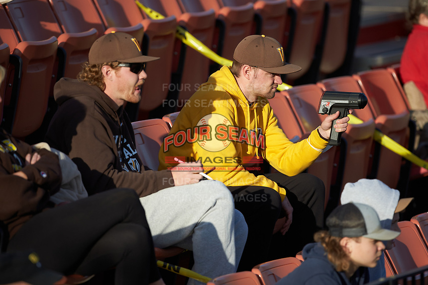 Valparaiso Crusaders student manager Sam Miller uses a radar gun during the game against the Western Kentucky Hilltoppers at Nick Denes Field on March 19, 2021 in Bowling Green, Kentucky. (Brian Westerholt/Four Seam Images)