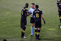 COLUMBUS, OH - DECEMBER 12: Referee Jair Marrufo talks to Jonathan Mensah #4 and Artur #8 of the Columbus Crew during a game between Seattle Sounders FC and Columbus Crew at MAPFRE Stadium on December 12, 2020 in Columbus, Ohio.