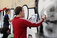 - Milan, young people paint a mural in the Park of Basilicas in memory of friend Dax (Davide Caesare), of the  social center Orso, killed from some neo-fascist in  March of 2003....- Milano giovani dipingono un murale nel Parco delle Basiliche in memoria del compagno Dax (Davide Cesare), del centro sociale Orso, ucciso da alcuni neofascisti nel marzo del 2003