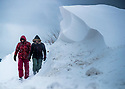 02/03/18<br /> <br /> Hikers, Chloé Kirkpatrick and Ben Lester, walk along a road closed by massive snowdrifts in Sparrowpit near Buxton in the Derbyshire Peak District.<br />   <br /> All Rights Reserved F Stop Press Ltd. +44 (0)1335 344240 +44 (0)7765 242650  www.fstoppress.com