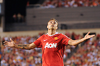 Dimitar Berbatov (9) of Manchester United waits for a ball to come down. Manchester United (EPL) defeated the Philadelphia Union (MLS) 1-0 during an international friendly at Lincoln Financial Field in Philadelphia, PA, on July 21, 2010.