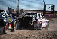 Dec. 9, 2011; Chandler, AZ, USA;  LOORRS pro 4 unlimited driver Carl Renezeder (17) and Kyle LeDuc (99) during qualifying for round 15 at Firebird International Raceway. Mandatory Credit: Mark J. Rebilas-
