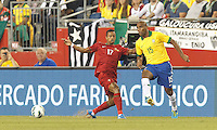 Brazil defender Maicon (15) flicks a pass as Portugal forward Nani (17) closes. In an international friendly, Brazil (yellow/blue) defeated Portugal (red), 3-1, at Gillette Stadium on September 10, 2013.