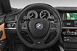 Car pictures of steering wheel view of a 2015 BMW X4 M sportpakket 5 Door SUV 2WD Steering Wheel