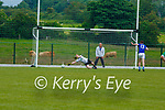 Milltown-Castlemaine keeper Cormac Leane cant keep out Dylan O'Neill LAune Rangers penalty during their Div 3 clash in Milltown on Sunday