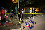 Residents try to make their way home as the NYPD investigates a double shooting at the Atlantic Terminal Houses at 487 Carlton Ave. (NYCHA) on July 18, 2020 in the Clinton Hill neighborhood of the Brooklyn borough of New York City.  Photograph by Michael Nagle