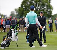 3rd July 2021; Mount Juliet Golf Club, Kilkenny, Ireland; Dubai Duty Free Irish Open Golf, Day Three; Rory Mcilroy of Northern Ireland talks to Matthew Jordan of England on the 2nd fairway