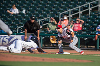 Northwest Arkansas Naturals outfielder Khalil Lee (24) safely dives back to first ahead of the throw to Arkansas Travelers infielder Evan White (10) during a Texas League game between the Northwest Arkansas Naturals and the Arkansas Travelers on May 30, 2019 at Arvest Ballpark in Springdale, Arkansas. (Jason Ivester/Four Seam Images)