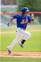 Arnaldo Berrios (13) of the Kingsport Mets hustles down the first base line against the Greeneville Astros at Hunter Wright Stadium on July 7, 2015 in Kingsport, Tennessee.  The Mets defeated the Astros 6-4. (Brian Westerholt/Four Seam Images)