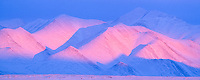 Pink alpenglow on the Philip Smith Mountains of the Brooks Range, Arctic, Alaska.