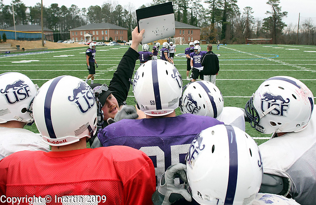 ROME, GA - DECEMBER 17: University of Sioux Falls defensive line coach Jared Schwanz is the scout team coach and shows plays that Lindenwood's offense will run at practice on Thursday afternoon, Dec. 17 at Shorter College in Rome, Georgia. The University of Sioux Falls Cougars are in Rome to play Lindenwood University Lions for the NAIA Football Championship on Saturday. (Photo by Dave Eggen/Inertia)