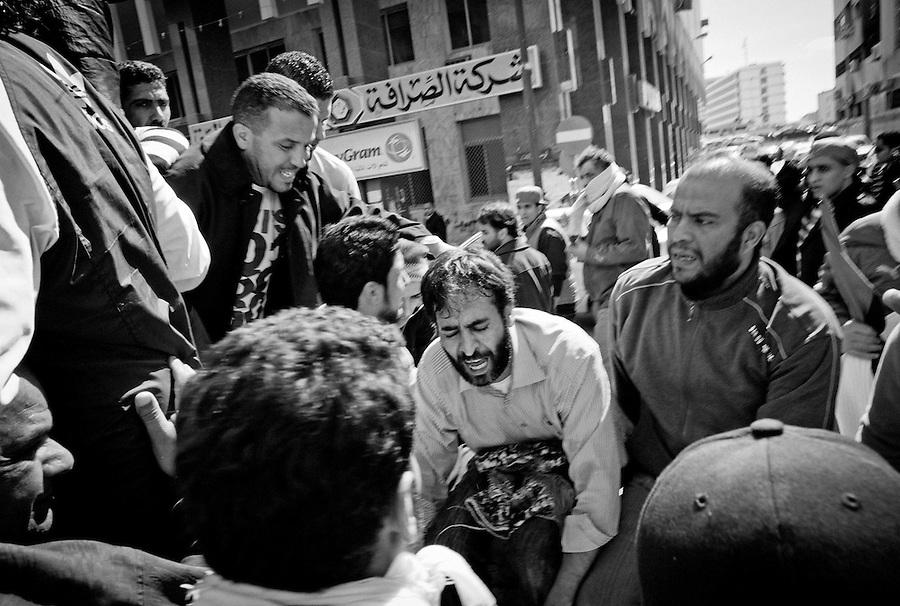 Man yells during funeral procession through the streets of Benghazi, Libya.