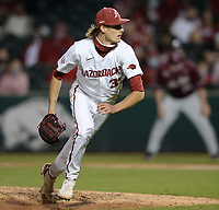 Arkansas reliever Caden Monke moves off of the mound to field a ground ball Tuesday, April 6, 2021, during the seventh inning of play against UALR at Baum-Walker Stadium in Fayetteville. Visit nwaonline.com/210407Daily/ for today's photo gallery. <br /> (NWA Democrat-Gazette/Andy Shupe)