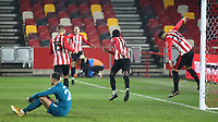 Brentford players celebrate their opening goal scored by Josh DaSilva during Brentford vs Newcastle United, Carabao Cup Football at the Brentford Community Stadium on 22nd December 2020