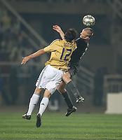 Jared Watts heads the ball over Alvaro Morata (12). Spain defeated the U.S. Under-17 Men National Team  2-1 at Sani Abacha Stadium in Kano, Nigeria on October 26, 2009.