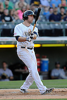First baseman Lars Anderson (27) of the Charlotte Knights bats in a game against the Columbus Clippers on Saturday, June 15, 2013, at Knights Stadium in Fort Mill, South Carolina. Columbus won, 4-2. (Tom Priddy/Four Seam Images)
