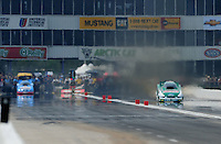 May 1, 2011; Baytown, TX, USA: NHRA funny car driver John Force (right) against Brian Thiel in the first round during the Spring Nationals at Royal Purple Raceway. Mandatory Credit: Mark J. Rebilas-