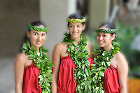 Hula dancers with open-ended maile lei and ti leaf headbands before a performance at the Hilton Hawaiian Village resort in Waikiki, O'ahu.