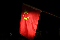 CHINA. Beijing. A Chinese flag being held by supporters during the opening ceremony of the Beijing Summer Olympics. 2008