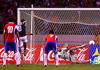 SAN JOSE, COSTA RICA - September 06, 2013: Clint Dempsey (8) of the USA MNT scores from the penalty spot against Keylor Navas (1) of the Costa Rica MNT during a 2014 World Cup qualifying match at the National Stadium in San Jose on September 6. USA lost 3-1.