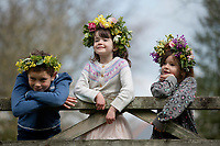 BNPS.co.uk (01202 558833)<br /> Pic: ZacharyCulpin/BNPS <br /> <br /> Weather input - <br /> <br /> Crowning glories: Dorset Flower Farmers, the Priestley family perfect their flower crown-making ahead of Garden Day on Sunday 9th May, the nationwide celebration of the benefits of gardens for health and wellbeing.  <br /> <br /> Pictured: Siblings Milo, 9, and Arabella, 5, Isadora Priestley, 7, show off their flower crowns in the ?garden<br /> <br /> Garden Day will be back for a third successive year on Sunday, 9th May 2021 to celebrate outdoor and indoor garden spaces. The nationwide  movement is calling on plant-lovers to make a flower crown, and share their plant spaces with family and<br /> friends