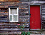Delaware Water Gap National Recreation Area, NJ<br /> Weathered red door and front face of the Depue House in Millbrook Village historic site