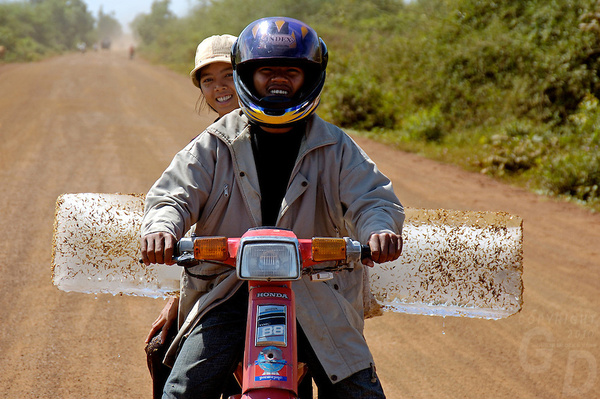 Images from the Book Journey Through Colour and Time, the local transportation of Ice on a motor bike, approx. 100 km from Siam Reap, this couple taken the ice to their local village,Cambodia