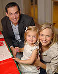 Joe and Heidi Krothe with Carly,2, at the fourth annual Home Sweet Home Gingerbread Bash presented by BBVA Compass benefitting the Children's Museum  Saturday Dec. 05,2009. (Dave Rossman/For the Chronicle)